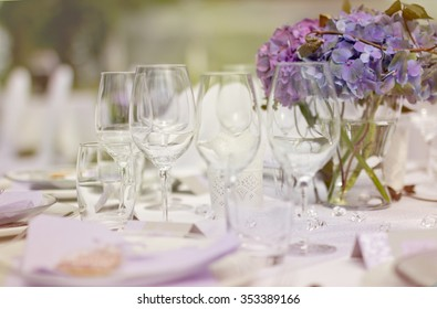 Romantic outdoor Big Day- white tablecloth with table set, glasses and fresh blue flowers