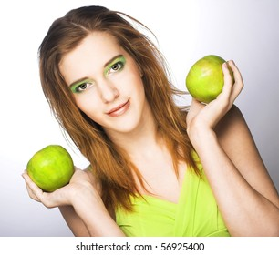 Romantic portrait of young woman with green apple