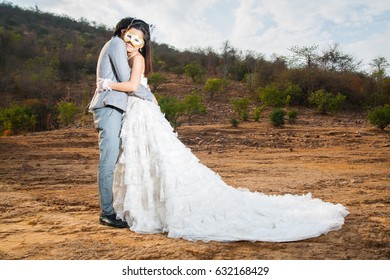 Romantic Prewedding of couple wear Mask with view on mountains