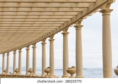 Romantic promenade, pergola in Porto, Portugal - Pergola da Foz near the Atlantic ocean, a structure in neoclassical style, painted in golden yellow