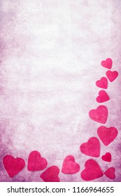 romantic red hearts over pink background in grunge vintage style with copy space