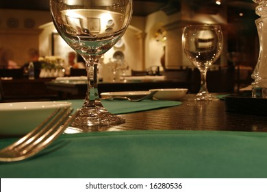 a romantic restaurant with fork and glasses
