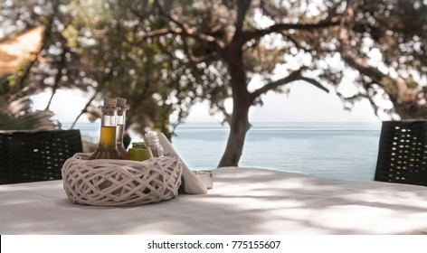 romantic restaurant with sea view on the mountain next to trees in Corfu Greece .condiments support on the table