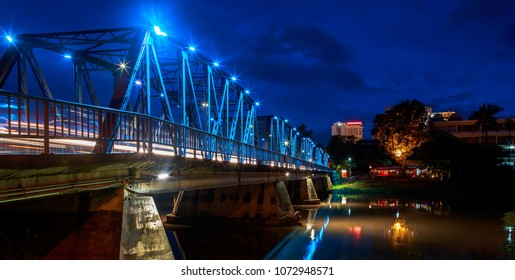 Romantic Sapaan Bridge spans over the Ping River in Chiang Mai, Thailand at night