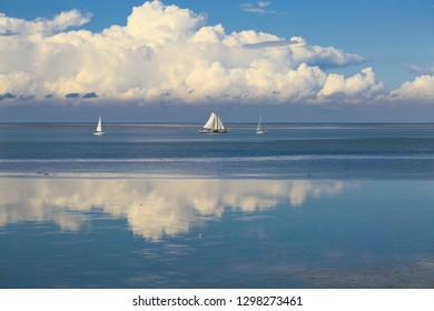 Romantic Sea View of Sailing Boats, Blue Sky and Beautiful White Clouds on Waddezsee in Holland taken from the Afsluitdijk