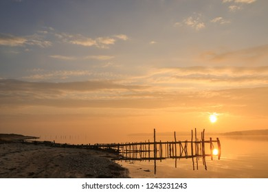 romantic seascape with sunset as burial at sea concept