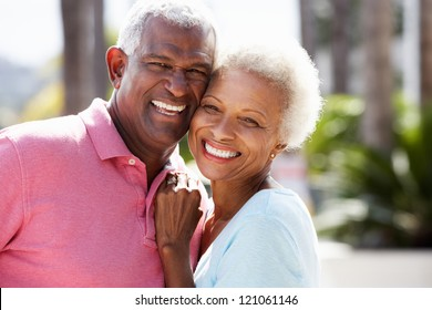 Romantic Senior Couple Hugging In  Street
