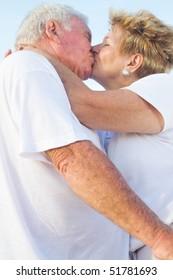 romantic senior couple kissing