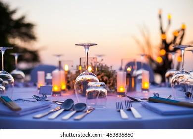 Romantic set up dinner set on the beach.(Selective focus)