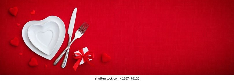 Romantic Setting Table  - Cutlery And Plates On Red Table