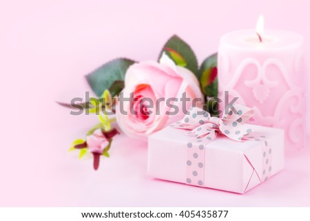 romantic setting wrapped gift lit candle stock photo edit now