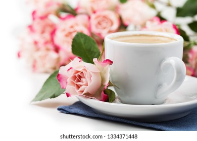 Romantic setup with cup of coffee and roses