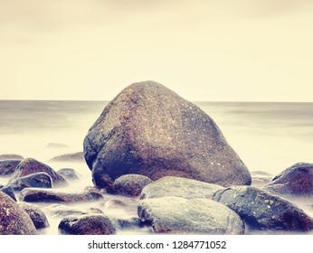 Romantic soul of sunset. Long exposure of sea and rocks and stones