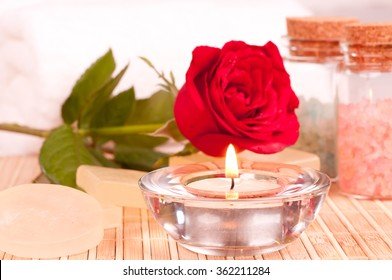 Romantic spa getaway with rose, candle, soaps, bath salt and towels background