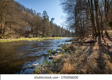 Romantic spring river valley with old cabin under blue sky. Sunny day on Oslava river, Czech Republic, Europe. - Shutterstock ID 1703506030