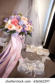 Romantic still life beautiful bridal bouquet tied with silk ribbons
