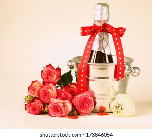 romantic still life champagne, roses, gifts, chocolate (toned in retro style)