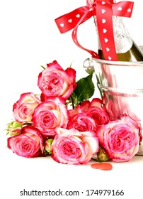 romantic still life champagne, roses, gifts, chocolate