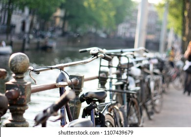 Romantic street with bicycles in Netherlands. Vintage retro fixed gear bike and tree on street urban scene, vintage old retro bike, cycling or commuting in city urban environment, ecological transport