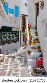 Romantic Street of Greek island with flowers and white buildings. mykonos