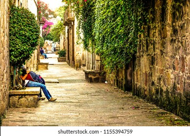 Romantic street in Morelia, Mexico. Young couples flirting.