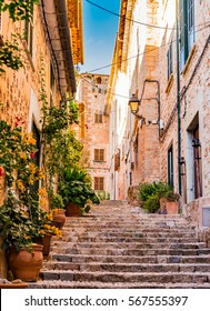 Romantic street in the picturesque small town Fornalutx, Majorca Spain, Mediterranean Sea Island.