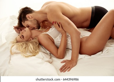 Romantic style portrait of lovers in the luxurious bedroom