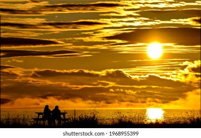 Romantic sunset in the evening sky. Sunset romance scene. Sunset date scene. Beautiful romantic sunset landscape