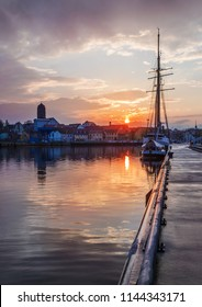 a romantic sunset in the harbor of Wolgast (Germany)