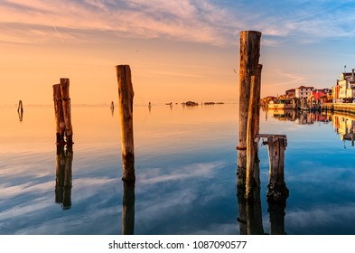 Romantic sunset on the Venice lagoon. Island of Pellestrina and town.
