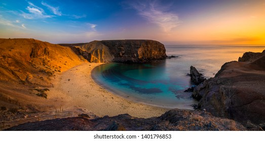 Romantic sunset over the beautiful, natural and sandy beach of Papagayo on Lanzarote