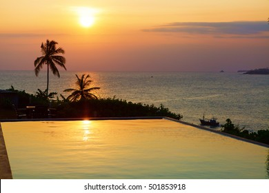 Romantic sunset at pool and sea