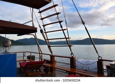 Romantic Sunset scene in the middle of the sea, looking out from a traditional rigged Bugis Phinisi Schooner vessel