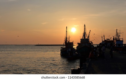 Romantic Sunset scene in Thailand, Fishing Boat anchored at the pier near Sri chang Island, Thailand