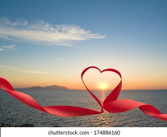 Romantic sunset at sea picture with ribbon and heart