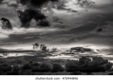 Romantic sunset sky with fluffy clouds and beautiful heavy weather landscape for use as background images and illustrations in the color tone black and white