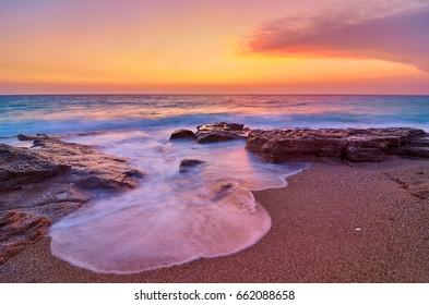 Romantic sunset view over beach in Lefkada island- Greece