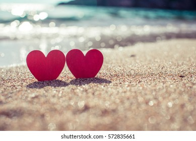 romantic symbol of two hearts on the beach