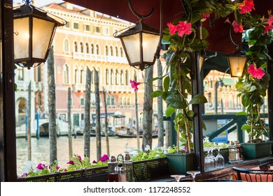 Romantic table by a canal in Venice, Italy