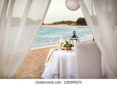 Romantic table setting in the evening on Bali island, Indonesia