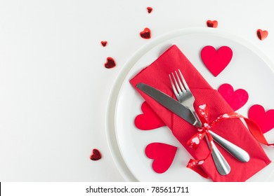 Romantic table setting on white wooden table.Valentine's day card template