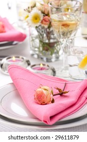 Romantic table settings. Arrangments with fresh roses and scented candles