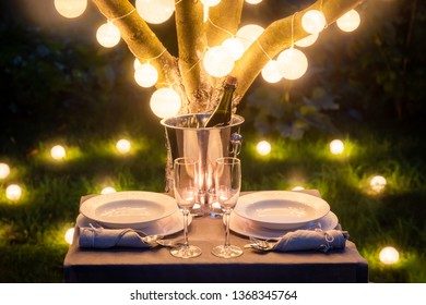 Romantic table for two with champagne and glasses