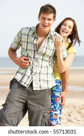 Romantic Teenage Couple Embracing On Beach
