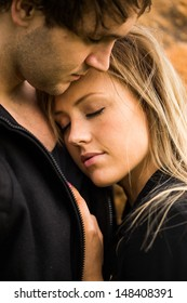 Romantic, tender moment of a young attractive couple. Pretty adorable girl closing her eyes