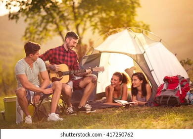 Romantic time on camping two men singing girls in the tent
