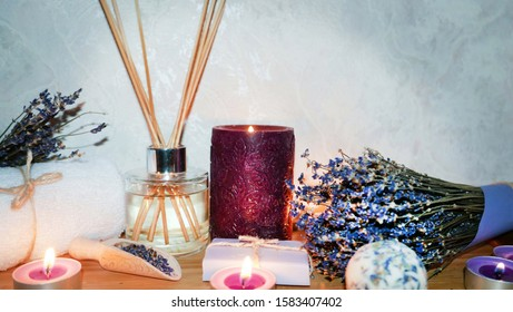 Romantic time with spa composition, with lavender flowers ,pink candles ,white towel on a nature table -Image
