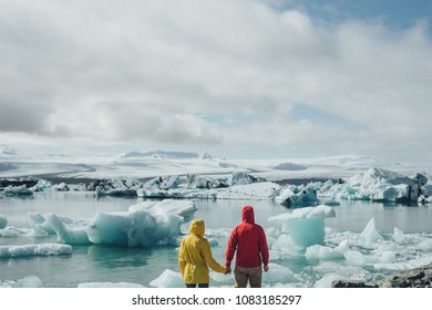 romantic Tourists couple in Iceland near glacial lagoon .