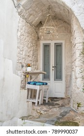 Romantic urban table and chairs for two people, Ostuni, Italy