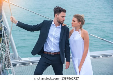 Romantic vacation and luxury travel. Couples, grooms, young businessmen and beautiful brides kissing romantic honeymooners yacht deck. Sailing the sea.